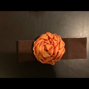 Other - Brown headband with orange flower